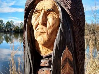 Hand carved wooden Indian head with bear headdress