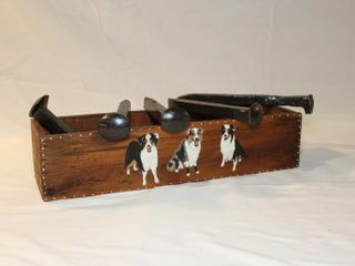 5 railroad spikes and wooden box with dogs
