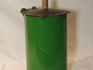 green round metal container with cast lid