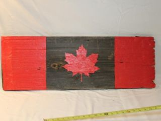 Canadian flag painted on barn board