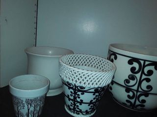 4 Flower Pots 3 of which are Black and White