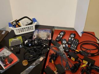 Assorted remotes and ac adapters batteries and more