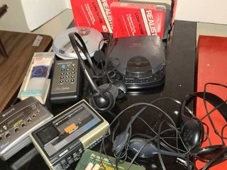 Assorted Walkman and Fishman and 8 track tapes