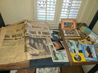 Vintage newspapers with vintage postcards