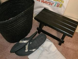 Small wooden stool with ladies socks and retirement T shirt