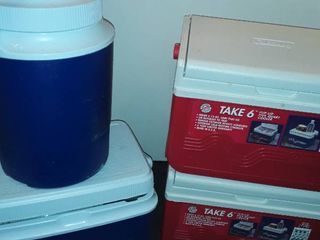 Three 5 qt  Coolers and Rubbermaid Water Jug