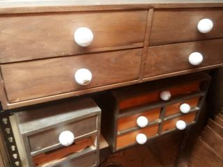 wood storage drawers with golf ball knobs with contents