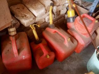 Gas cans  1 gallon and 2 1 2 gallons