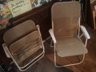 pair of tan folding mesh chairs