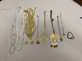 ladies jewelry   Eight necklaces with one pair of matching earrings and a watch