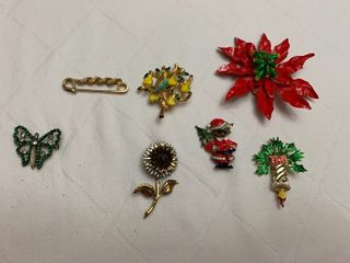 ladies jewelry  three pins and four Christmas pins