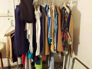 Vintage Clothing on Rack in Basement   Rack Not Included