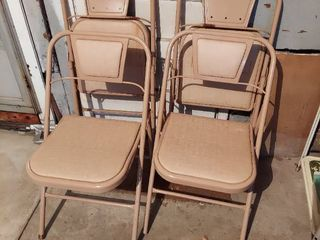 4 Folding Chairs   2 have Rust Spots