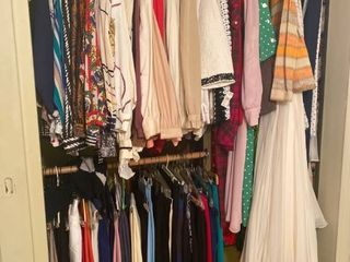 lot of women s blouses and pants  some dresses