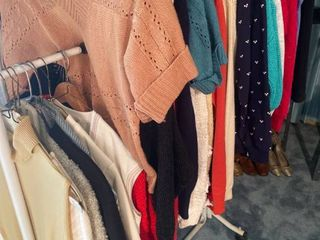 all womens sweaters and clothes on rack   rack not included