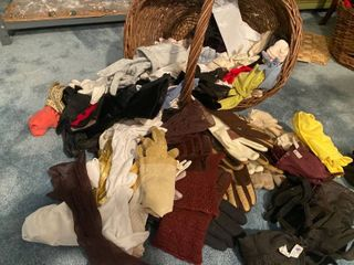 MANY pairs of women s gloves with basket