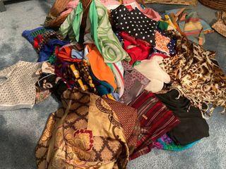 lot of fashion scarves and large decorative basket