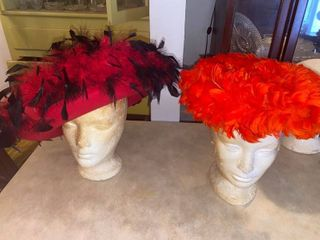two Red feather hats