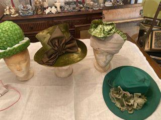 4 green hats