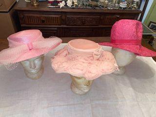 3 pink hats