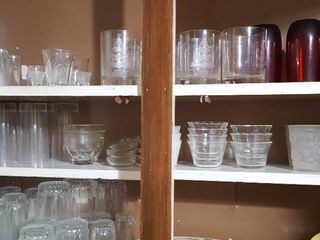 3 shelves of glassware