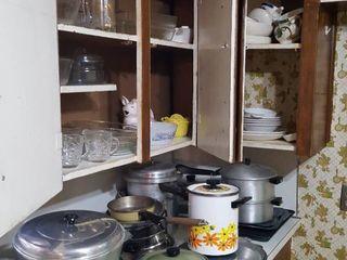 assorted cookware in corner of kitchen