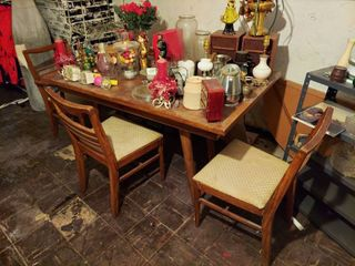 Oak Dinning Table and 3 Chairs   2 side chairs need re glued  upholstery is dirty   Contents Not Included   In Basement