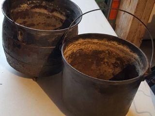 2 cast iron flower pots