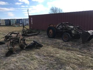 8N Ford tractor with bucket  brush hog  sod bucket  disc  plow and 2 extra wheels