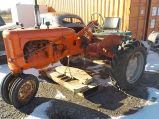 Allis Chalmers tractor with a woods l503 belly mower