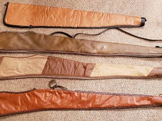 4 Soft Side Rifle Cases  44 in  to 52 in    all zippers work   some damage