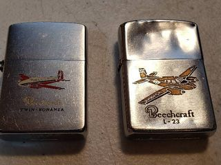 2 Vintage Beechcraft Zippo Advertising lighters   Twin   Bonanza and l 23 US Army