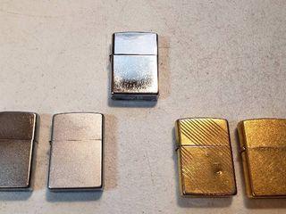 5 Vintage Zippo lighters   2 Brushed Silvertone  2 Goldtone or Brass  and Polished Chrome