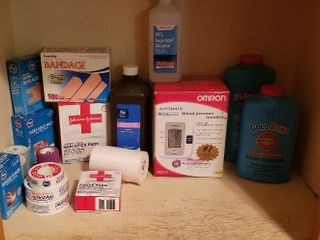 Household Medical Items  Blood Pressure Monitor  Bandages  and Foot Powder