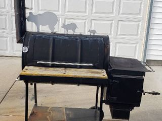 Custom Made BBQ Grill   Smoker from 55 Gal  Barrel   Heavy but has wheels fir mobility   60 x 40 x 69 in  tall  top of smokestack