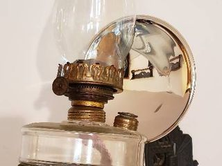 Vintage Oil lamp on Cast Iron Wall Sconce w Mercury Glass reflective disc   7 x 12 x 17 in  tall