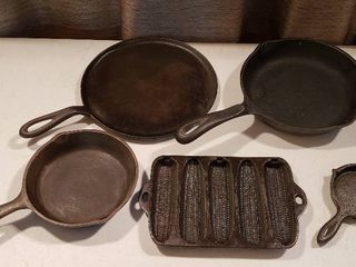 5 Cast Iron Cooking Pans  Flat Skillet  2 Small Skillets  Cornbread Mold and One Egg Skillet