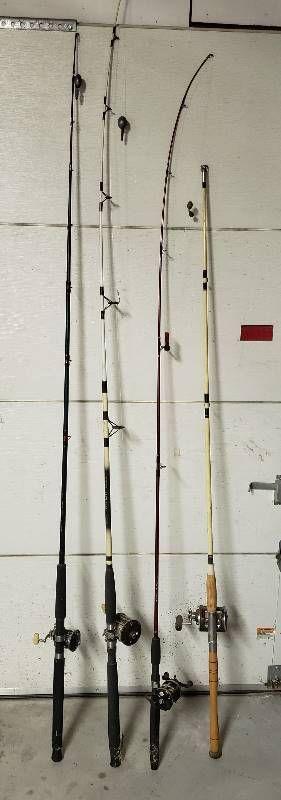 4 Fishing Poles w Reels