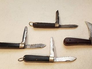 4 Camillus Pocketknives   Single Hook Blade  1 and 3 Two Blades  27  various conditions   1 wood and 2 bakelite handles