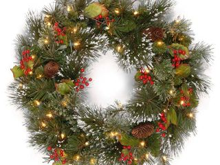 National Tree Wintry Pine Wreath with Cones  Red Berries and Snowflakes  24 Inch  50 Clear lights