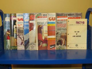 lot of vintage Gun Sport magazines and Army Field Manual