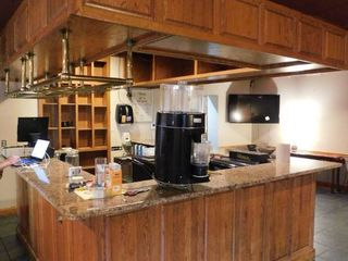 U Shaped Bar With Granite Style Top   Overhead Cabinets