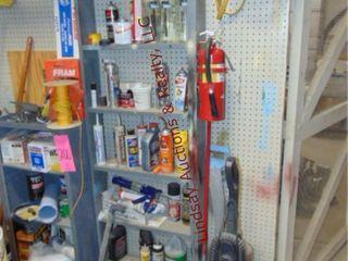 2 shelves full of misc fluids  vaccum  trash bags