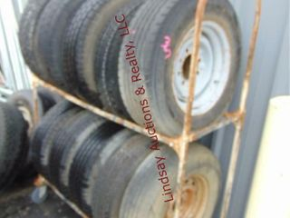 10 various size used tires WITH rack  some w  whls