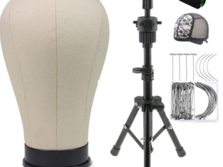 Black wig tripod stand it comes with variety pack needles and a wave cap