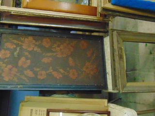 Assorted wood frames and wall hangings
