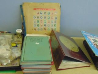 Assorted stamp albums with old stamps inside