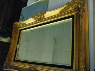 Gold toned wood frame mirror