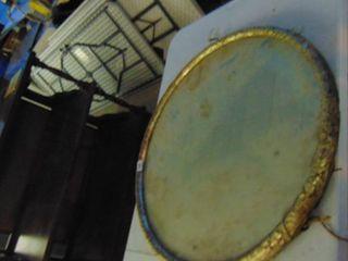 Antique mirror with brass frame