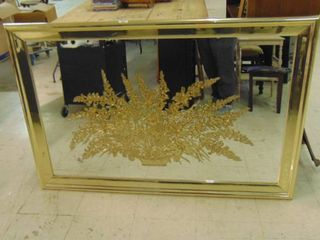 Mirrored picture of fern with brass frame
